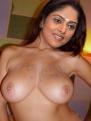 Nude milf Nadhiya showing her boobs to suck