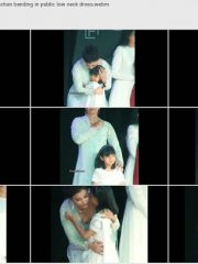 Hot cleavage Aishwarya Rai Bachchan bending in public low neck dress